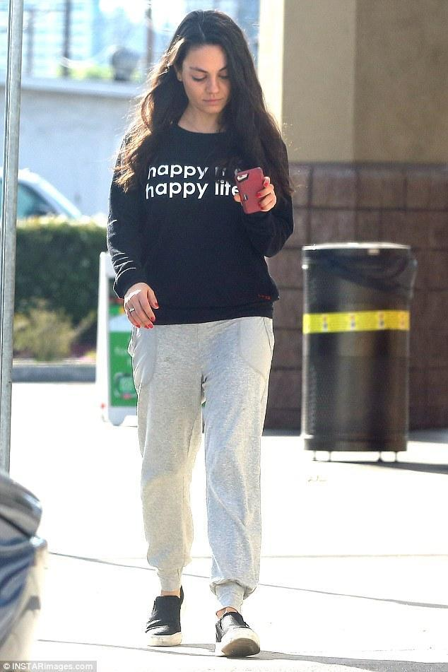 Mila Kunis Wearing Timberland Mayliss Slip On Shoes In Black Snake Suede And Peace Love
