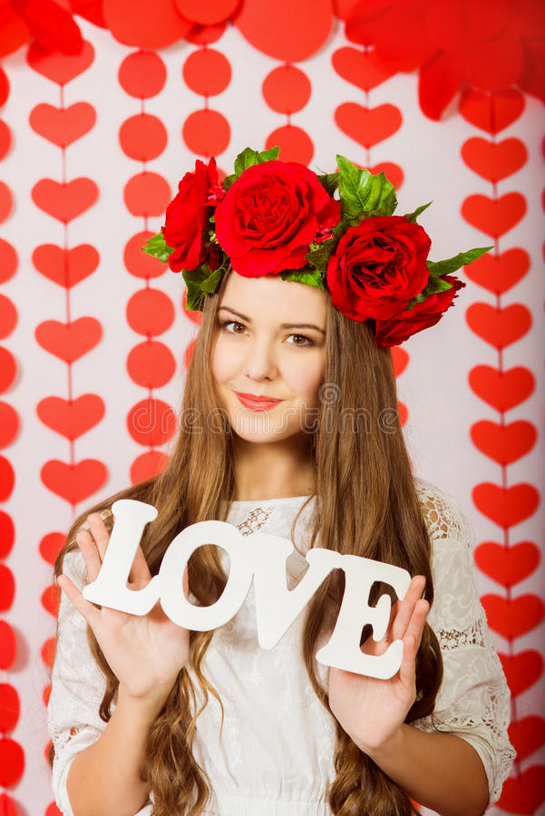 Download Beautiful Girl In Red Wreath Of Flowers With The Word Love Stock P O Image