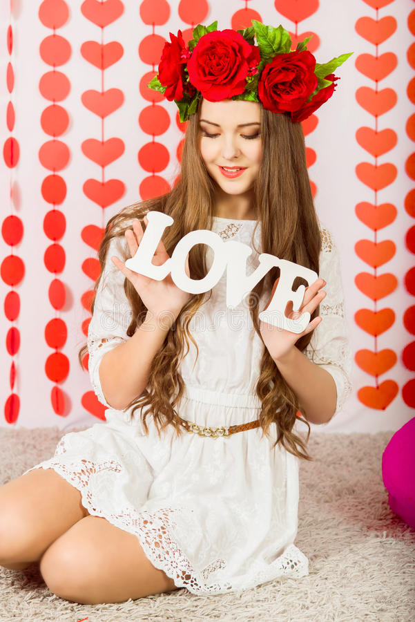 Download Beautiful Girl In Red Wreath Of Flowers With The Word Love Stock Image Image