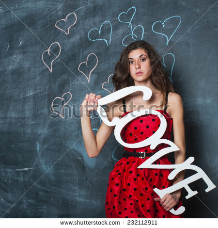 Beautiful Girl Holding Love Word Sign