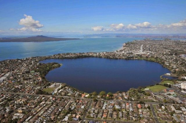 Lake Pupuke, a heart-shaped freshwater lake on the north coast of Auckland that was formed by a volcanic explosion